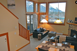 cozy canmore mountain condo in the Canadian rockies with panoramic mountain views in canmore, alberta, canada; pet friendly vacation condo in banff canada